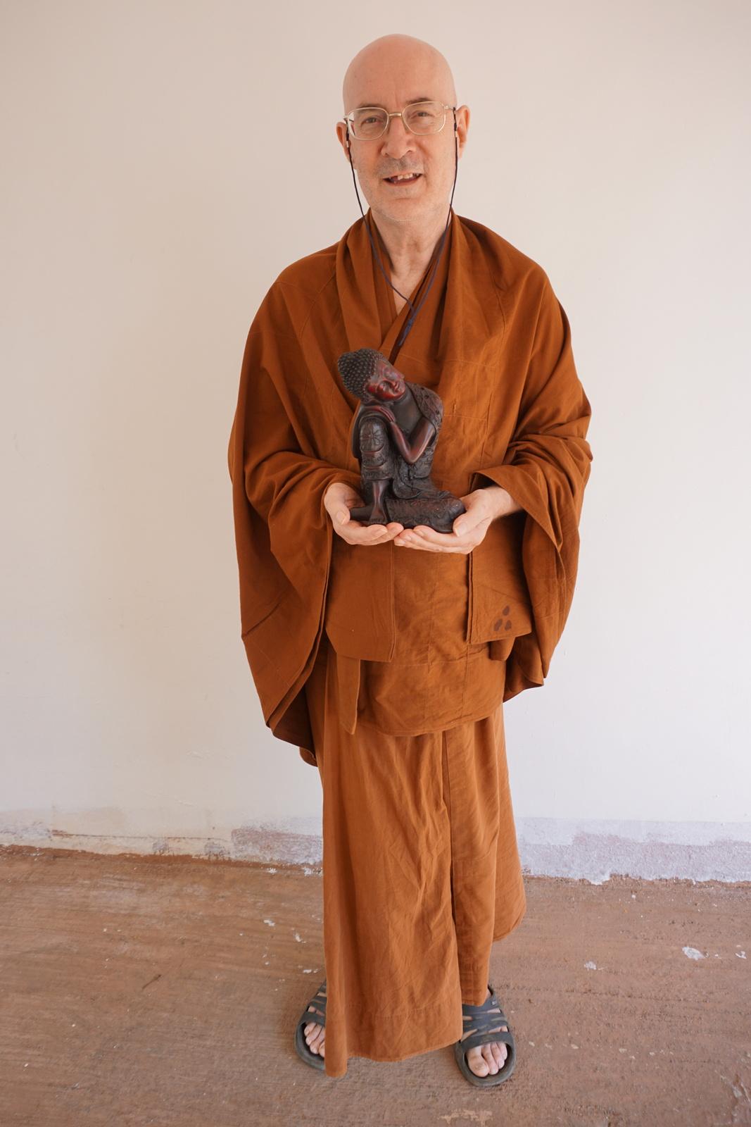 Anandajoti with Buddha Statue